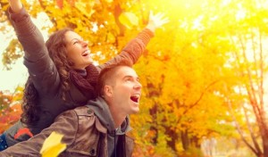 couple-playing-in-leaves