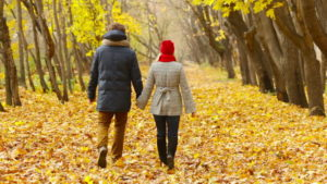 couple-walking-in-the-woods
