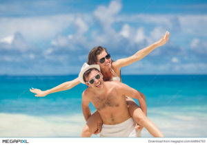 happy couple on beach arms out