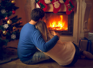 christmas couple with fireplace