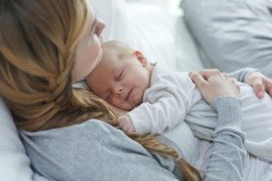 baby sleeping on mom